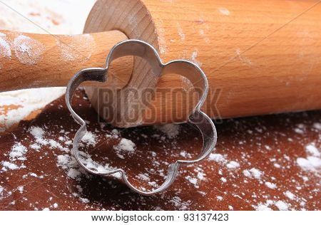 Cookie Cutters And Rolling Pin On Dough For Cookies