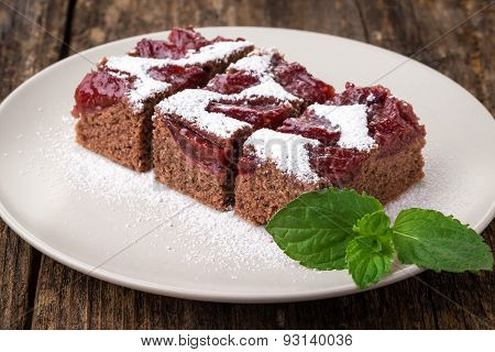 Sliced Piece Of Plum Cake With Cocoa