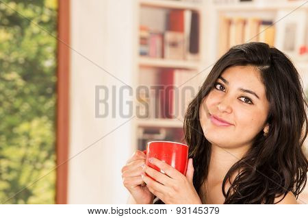 Hispanic model with coffee cup