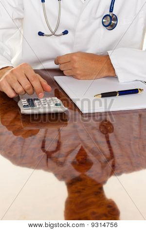 Doctor With A Calculator. Costing Medical Practice