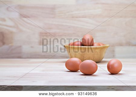 Hen's Eggs In Wooden Bowl