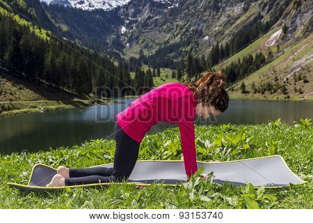 Woman Doing Cat Pose Outdoors