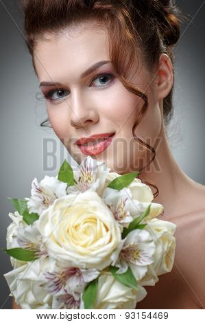Young Cute Smiling Woman With A Bouquet Of Roses And Orchids.