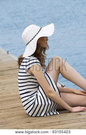 Cute Girl Sitting Near Lake