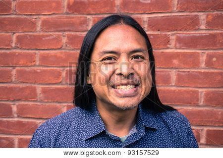 Grinning Asian man