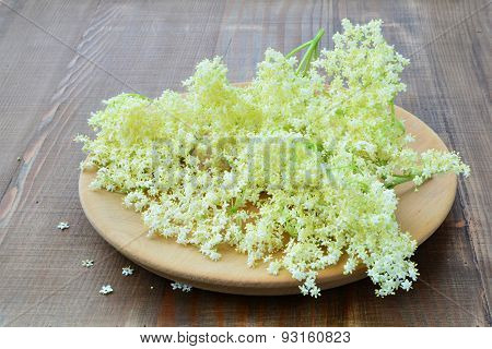 Elderflower Blossoms On Wooden Background