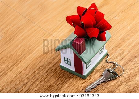 house with red ribbon as a gift