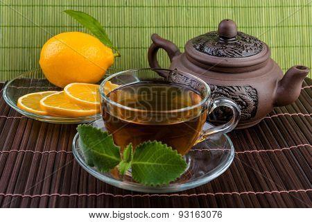 ceramic tea pot and cup of tea