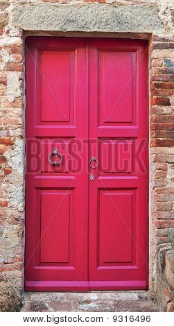 Wooden closed pink door.