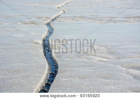 Fissure On The Ice. Picture Can Be Used As A Background