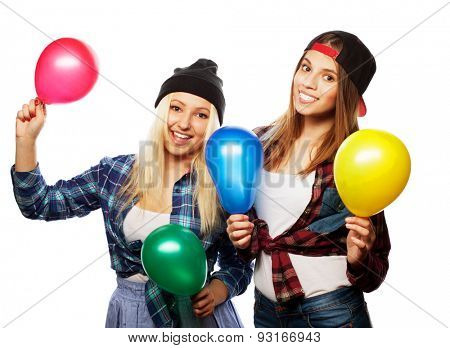 two girls friends with baloons