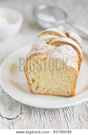 Sweet Brioche With Sugar On A White Plate On A Light Background