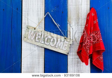 Rustic welcome sign hanging by red bandana