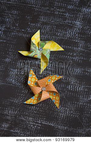 Homemade Paper Pinwheel On Dark Wooden Background
