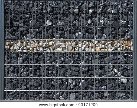 Dark gabion with a bright stripe