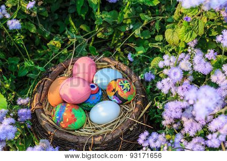 Colorful Easter Eggs In Grass Nest.
