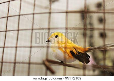 A vintage bird in a cage