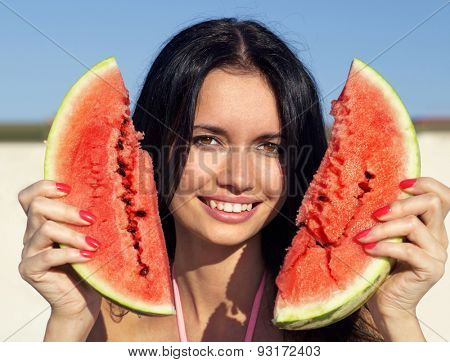 Beautiful happy girl with slice of ripe water-melon