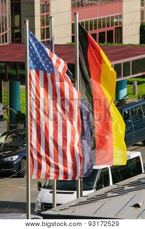 American And German Flags Waving On A Clear Summer Day