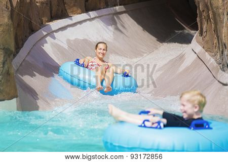 Family enjoying a wet ride down a water slide