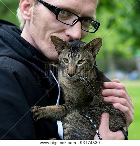 close up portrait man with the cat