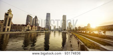 modern skyscrapers and skyline during sunset at riverbank  in china urban city and downtown district