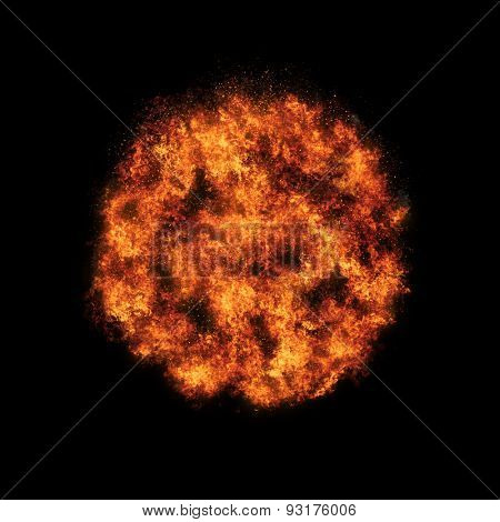 Realistic fire ball  explosion busting over a black background.