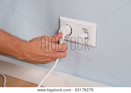 Closeup Of Hand Inserting An Electrical Plug