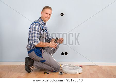 Electrician Stripping Wire In House