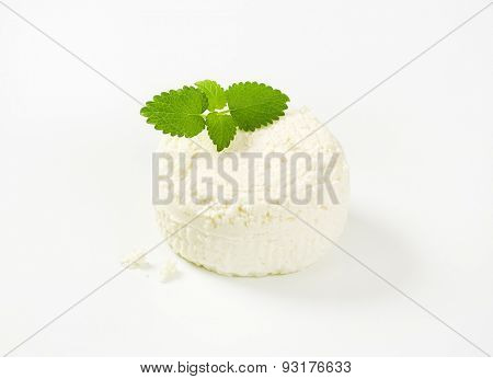 block of fresh curd cheese with mint on white background