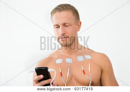 Young Man With Electrodes On Chest