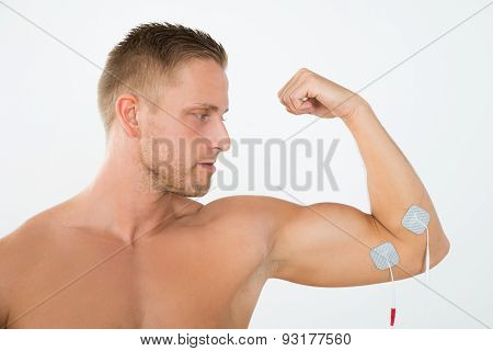 Man Having Electrotherapy Of Arm