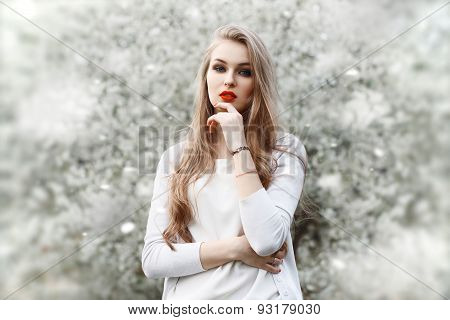 Spring Portrait Of A Beautiful Girl With Red Lips In The Spring Time.