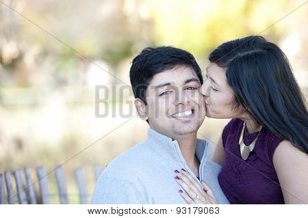 Young Happy Indian Girl Kissing Her Fiance