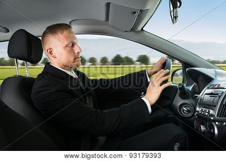 Businessman Sleeping While Driving Car