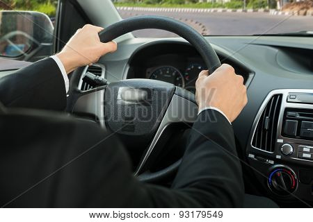 Close-up Of A Driver's Hand On Steering Wheel