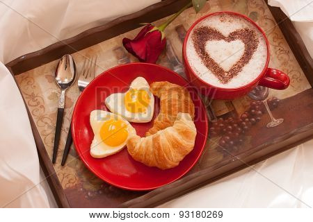 Breakfast in bed - Eggs, Croissant and coffee