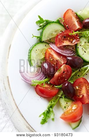 Tomato and cucumber salad with endive and olives