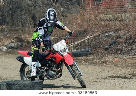 girl practicing on a motocross bike