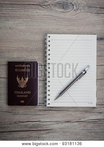 Passport With Notebook And Pen