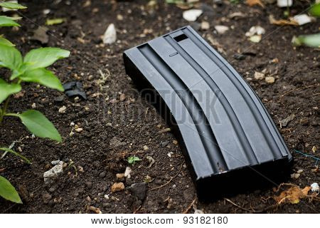 Airsoft gun magazine on the ground