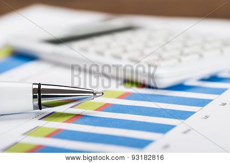 Financial Data Sheet With Calculator And Pen