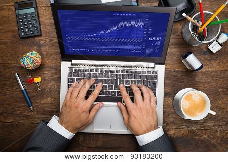 Businessman Analyzing Graph On Laptop
