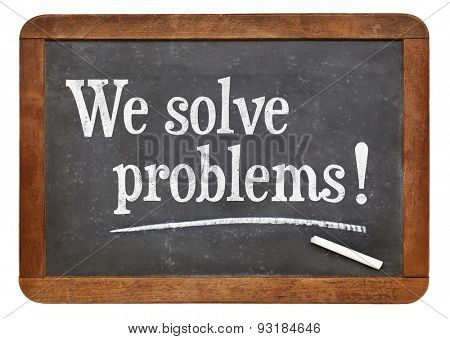 We solve problems  - text on a vintage slate blackboard - service marketing concept
