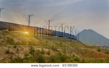 Freight Train Passing By On Sunset