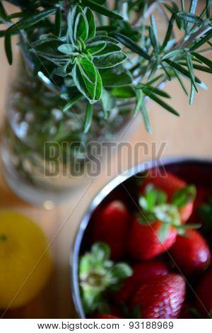 strawberries, lemon, and herbs