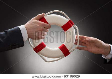 Close-up Of A Male's Hand Holding Lifebuoy