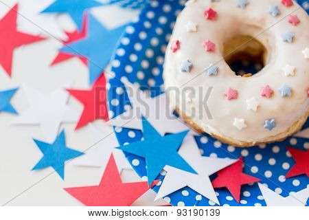 american independence day, celebration, patriotism and holidays concept - close up of glazed sweet donut with stars decoration on disposable plate at 4th july party from top