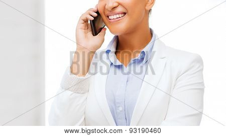business, and communication concept - smiling african businesswoman with smartphone in office
