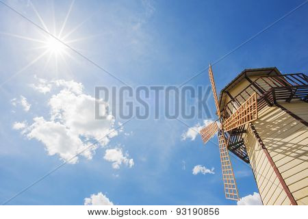 windmill and blue sky with sun star background.